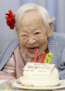 Japanese Misao Okawa, the world's oldest woman, poses for a photo next to her birthday cake as she celebrates her 116th birthday in Osaka, western Japan, in this photo taken by Kyodo March 5, 2014. Okawa celebrated her 116th birthday on Wednesday. Mandatory credit. CREDIT: REUTERS/KYODO