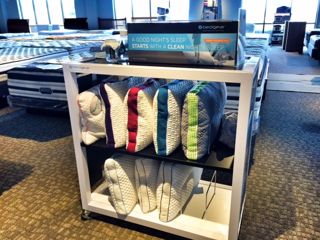 Our rack full of Bed Gear pillows!